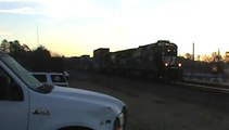 Train meet in Austell Ga. with NS 207 heading north bound and BNSF power leading NS 737 south bound