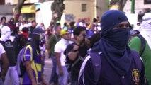 Venezuelan protesters clash with riot police in Caracas