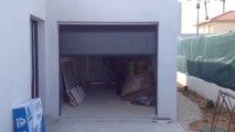 Porte de garage sectionnelle plafond G60 motorisée et installée par APG Accès Portes de Garage