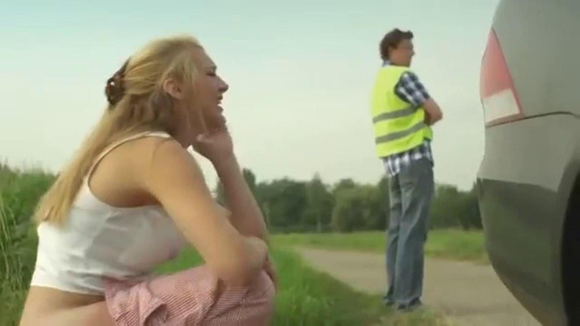 Women pulling their pants down
