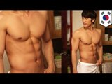 Korean actor Song Seung-heon (宋承憲) takes off his shirt for ratings
