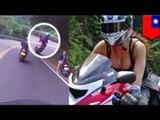 Taiwan scooter rider hits wall while gawking at hot girl