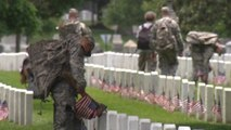 Memorial Day flags placed at Arlington National Cemetery graves