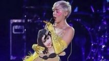 Miley Cyrus Throws Selena Gomez Photo During Concert