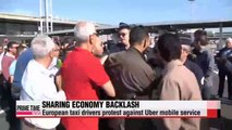 Taxi drivers in Europe protest over Uber cab service