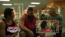 Strongman Robert Oberst bench presses with Mike Chang.