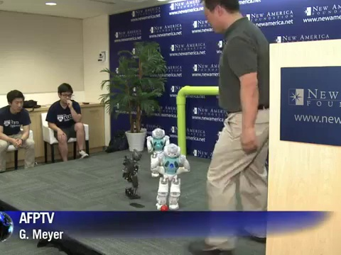 US students show off robots playing soccer