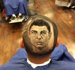 Barber extraordinaire 'Rob the Original' shaves Cristiano Ronaldo into a fan's head