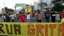 Demonstrators stage a silent protest in Copacabana