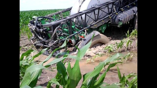Spray rig gets stuck in mud BAD