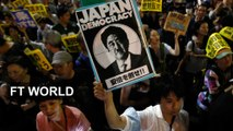 Japanese march against defence policy shift