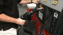 MoneyWatch: Oil prices dropping; Low interest rates help markets recover