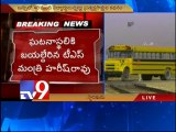 Train hits school bus at unmanned level crossing