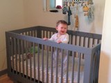 Baby Boogies Down in Her Crib