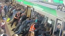 Australian commuters tilt train to free man's leg