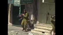 Resistance by palestinians at Hebron to Israeli force