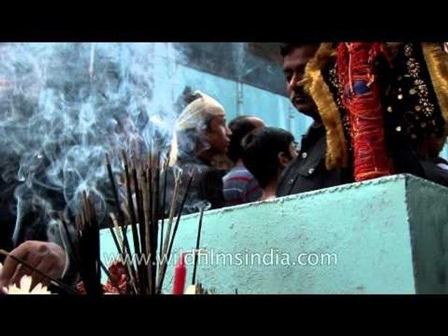 Shia Muslim devotees attend Muharram procession
