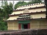 Stone carved sculptures of God inside Dhabaleswar Temple