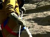 Students taking rappelling lessons near Manali in Himachal Pradesh, North India