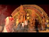 Devotees gather in front of puja pandal to worship Goddess Durga during Durga puja