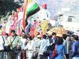 Mahouts (elephant riders) parade elephants for celebrating Holi