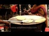 Paratha fry in a huge frying pan, Nizamuddin West