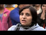 Physically handicapped lady persuading people to speak out against rape at Delhi Haat