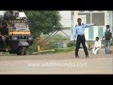Private security guards regulate traffic here in Gurgaon - no traffic cops!