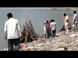 Hindus cremating dead bodies on the banks of the Ganges river in India