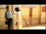 Beggar begging for money from a Tibetan man