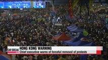 Hong Kong protests enter third week, leader warns of force