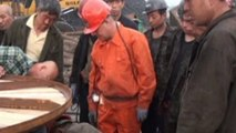 China mine rescue: Nine saved from flooded coal mine