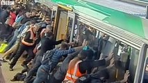 Australian commuters help free man trapped against platform