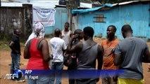 Relatives of Ebola victims wait for news at Liberia hospital