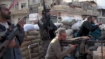 Heavy fighting continues between Syrian army and insurgents near capital