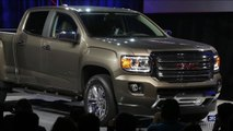 MoneyWatch: GM to hire hundreds to produce new models; Fed to announce policy decision