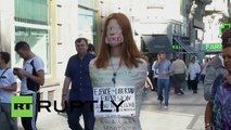 Spain: Activist covers herself in duct tape to protest 'gag law'