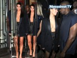 Kim Kardashian impresses in tuxedo jacket sneaking assets
