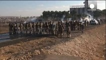 Turkish Kurds clash with police on border with Syria as Syrian Kurds stream into Turkey