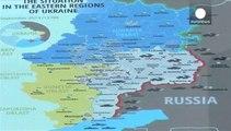 Украина: бои за аэропорт Донецка и полемика вокруг массовых захоронений