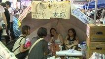HK democracy protesters still paralyse city despite rain