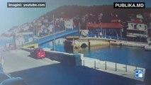 Trecătorii au rămas uimiţi! O şoferiţă a trecut la roşu şi a sărit cu maşina de pe un pod mobil