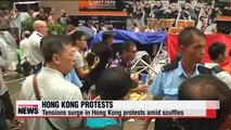 Tensions surge in Hong Kong protests amid scuffles between protesters, opponents