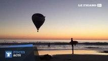 Une montgolfière sauvée par des surfeurs après avoir échoué dans l'eau