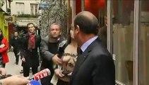 François Hollande interpellé par deux femens