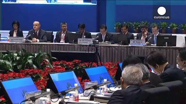 China soothes strains with Japan as APEC summit begins