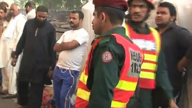 Building catches fire, mother throws baby out