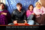 Babaları cephede olan çocukların gözü kulağı Kobanê'de