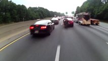 Dumb motorcyclist crashes while overtaking cars and lane splitting