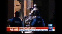 Hostages held in Sydney cafe, Islamic flag seen in window - local TV